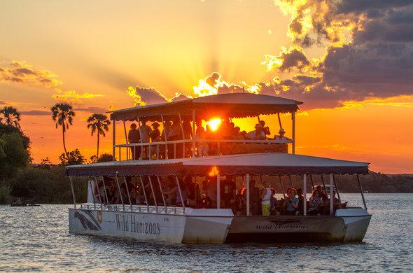 wild-horizons-sunset-cruise-lady-lu-sunset-behind-boat-590x390